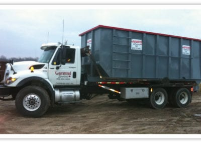 Roll of bins service truck